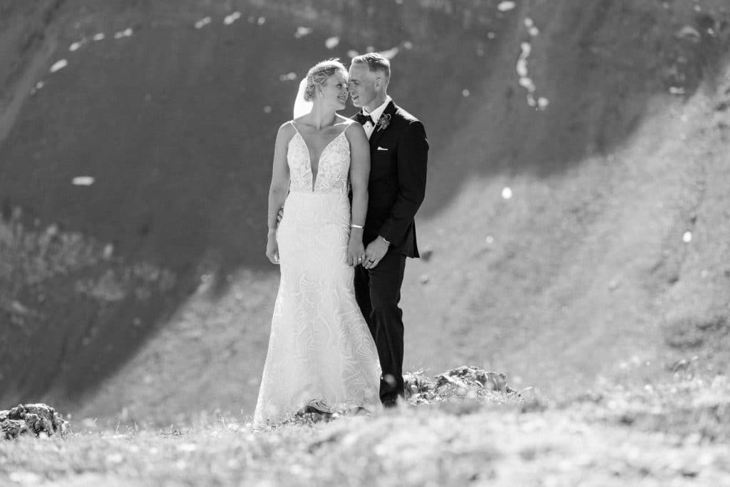 Bride and groom holding each other after their alpine helicopter wedding in Canmore Alberta