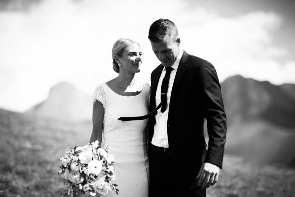 Banff elopement photographer photographs a moment between the groom and bride walking and laughing together before their ceremony