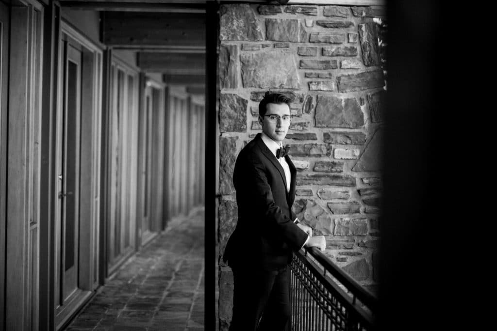 Portrait photograph of a groom at Azuridge Estate Hotel after he got ready photographed by Calgary wedding photographer