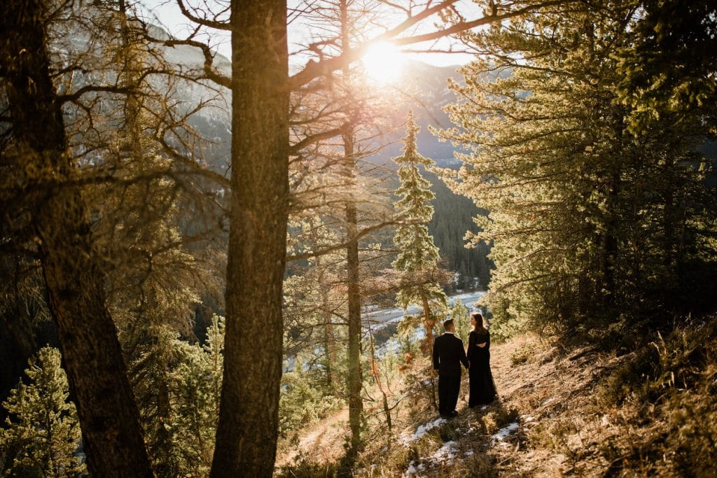 Banff photograph of an engaged couple as the sun goes down during a winter Canadian Rockies engagement shoot