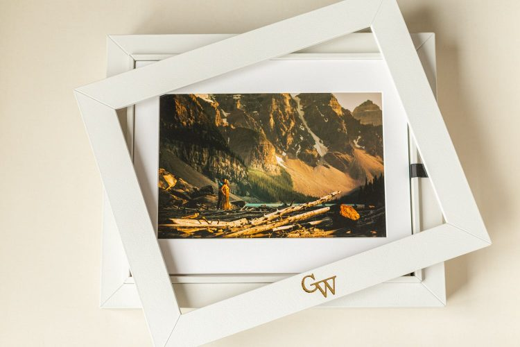 Matted portrait box containing matted prints from an engagement shoot from Moraine Lake