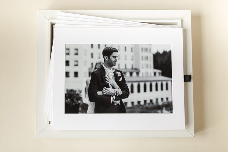first look photograph taken at Chateau Lake Louise with the bride hugging from behind displayed as a matted print