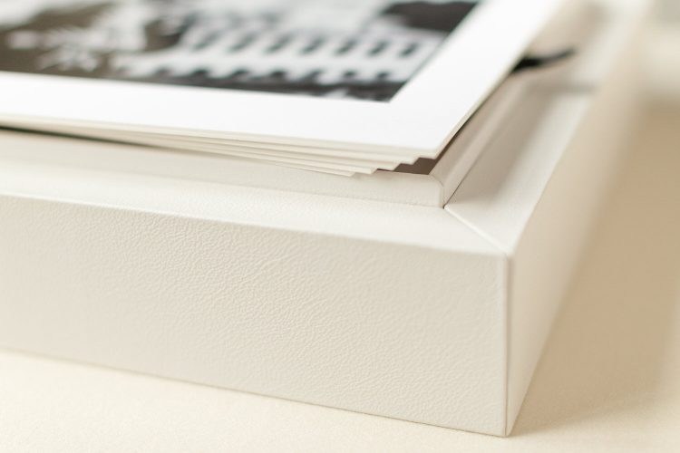 Close up engagement photos displayed as matted prints within a portrait box