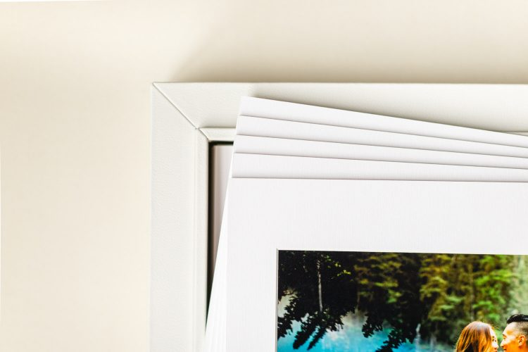 White leather distressed portrait box containing an engagement shoot in Banff National Park