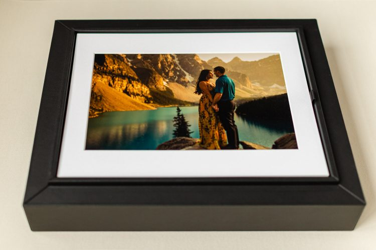 Portrait box containing matted 11x14 prints of an engagement shoot taken in Lake Louise